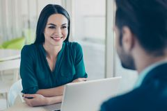 Young woman listening to her future colleague about new job in f Royalty Free Stock Photos