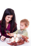 Young women with a little boy made advent wreath Stock Photography