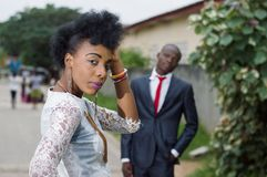 Young woman looking back and admired by her man. Royalty Free Stock Photo