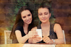 Young Women Looking at Smart Phone Screen Royalty Free Stock Image