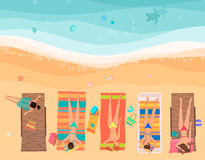 Young women lying on the beach near sea. Top view cartoon vector illustration. Stock Photos
