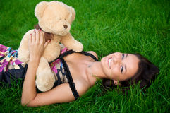 Young women lying on green grass Royalty Free Stock Image