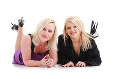 Young women lying on a white background Royalty Free Stock Images