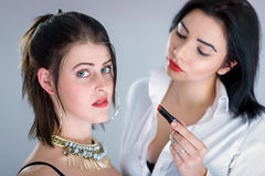 Young women making red lips Royalty Free Stock Photography