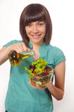 Young women making salad on white background royalty free stock photo