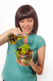 Young women making salad on white background stock photography