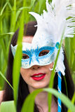 Young women in mask Royalty Free Stock Photo