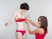 Young women measuring Stock Image