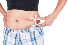 Young Women Measuring Fat Belly With Fat Caliper Royalty Free Stock Photo