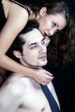 Young women with men Stock Images