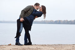 Young women and men flirt at lake. Outdoors photo stock photography