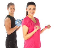 Young couple exercising with weights together Stock Photo