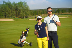 Young women and men playing golf Stock Photo