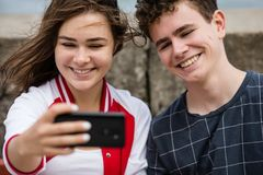 Young woman and man taking selfie photos Royalty Free Stock Images