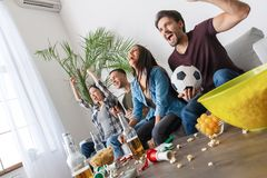 Group of friends sport fans watching football match hands up cheerful royalty free stock photo