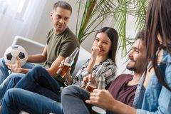 Group of friends sport fans watching football match discussion royalty free stock photos