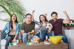 Group of friends sport fans watching soccer match shouting cheerful royalty free stock photo