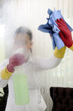 Young women mirror cleaning. Housework women cleaning mirror. microfiber cloth Stock Images