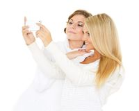 Young  women with a mobile phone. Stock Photo