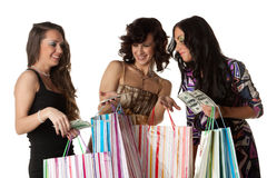 Young  women with money and shopping bags. Stock Images