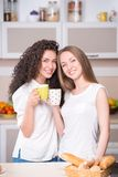 Young women with the morning cups of tea Royalty Free Stock Photography