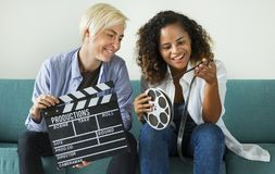 Young women with movie film reel royalty free stock photos