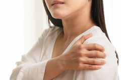 Young women neck and shoulder pain injury, healthcare and medical concept stock image