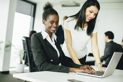 Young women in the office Stock Photo