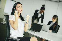 Young women in the office Stock Images