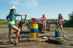 Young women on old gasoline station Royalty Free Stock Photography