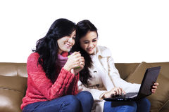 Young women online shopping Royalty Free Stock Photography