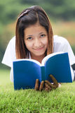 Young women open a book Stock Photography