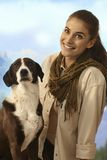 Young women outdoor with dog Royalty Free Stock Images