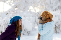 Young women outdoor taking photos Stock Images