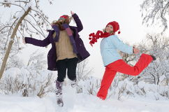 Young women outdoor in winter enjoying the snow Royalty Free Stock Photo