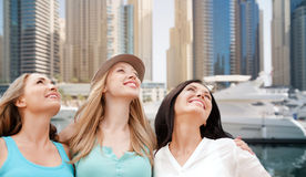 Young women over dubai city harbour and boats Stock Photo