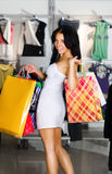 Young women with packages Stock Images