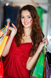 Young women with packages shopping Royalty Free Stock Photo