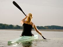 Young women paddling in kayak Stock Photos