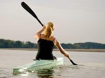 Young women paddling in kayak Stock Photos