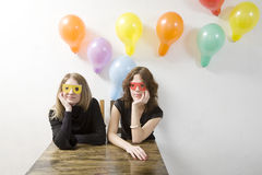 Young women with paper glasses Royalty Free Stock Photo