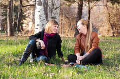 Young women in the park. Young women talking and laughing in the park Royalty Free Stock Images