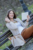 Young women in the park with tablet Stock Photos