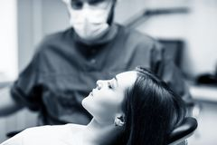 Young woman patient waiting treatment in stomatology clinic. Young women patient waiting treatment in stomatology clinic. Stomatology care concept stock image