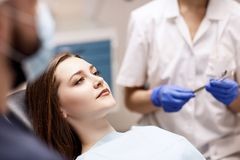 Young woman patient waiting treatment in stomatology clinic. Young women patient waiting treatment in stomatology clinic. Stomatology care concept stock photography