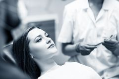 Young woman patient waiting treatment in stomatology clinic. Young women patient waiting treatment in stomatology clinic. Stomatology care concept royalty free stock photo