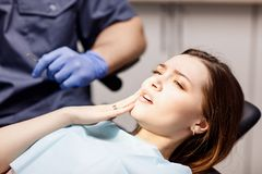 Young woman patient waiting treatment in stomatology clinic. Young women patient waiting treatment in stomatology clinic. Stomatology care concept royalty free stock images