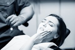 Young woman patient waiting treatment in stomatology clinic. Young women patient waiting treatment in stomatology clinic. Stomatology care concept stock images