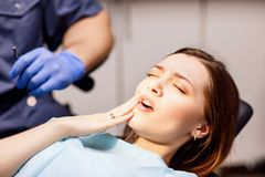 Young woman patient waiting treatment in stomatology clinic. Young women patient waiting treatment in stomatology clinic. Stomatology care concept stock photos