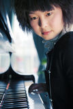 Young women with piano. Young asian women with piano Royalty Free Stock Photography